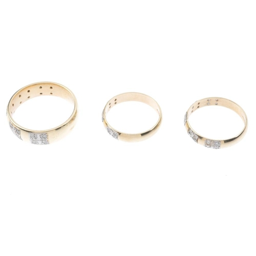 559 - Three diamond band rings. To include two designed as five brilliant-cut diamond quatrefoil panels in...
