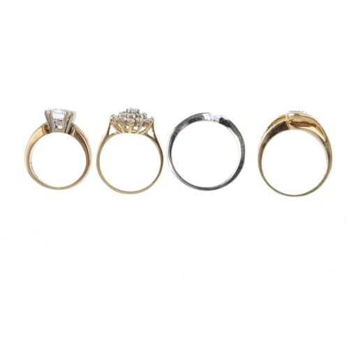 56 - Four gold cubic zirconia rings. To include a 14ct gold cubic zirconia crossover ring, a 9ct gold cub...