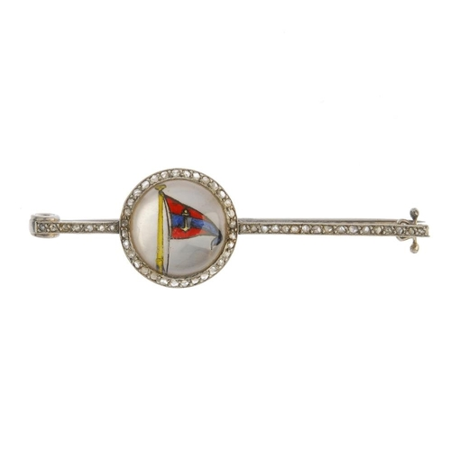 560 - A diamond reverse carved intaglio bar brooch. The reverse-carved intaglio depicting a flag, with mot...