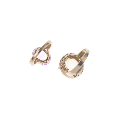 564 - Two 9ct gold gem-set dress rings. To include an oval-shape pink sapphire single-stone ring with cros...