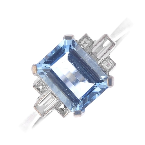 567 - An aquamarine single-stone ring. The rectangular-shape aquamarine, with baguette-cut and square-shap...