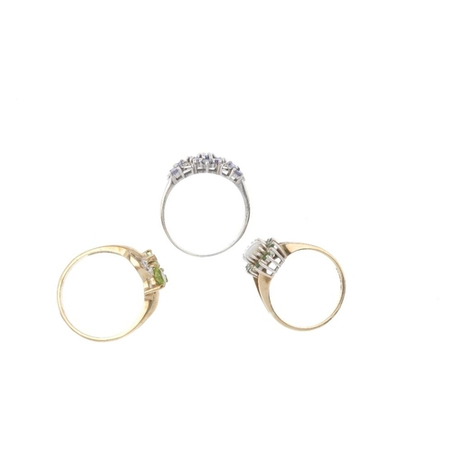 568 - Three 9ct gold diamond and gem-set rings. To include a tanzanite and diamond dress ring, a peridot a...