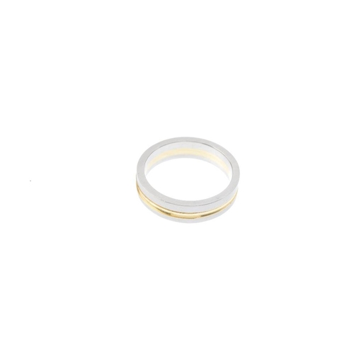 577 - A platinum and 18ct gold band ring. Of bi-colour design, the polished groove, with textured sides. H...