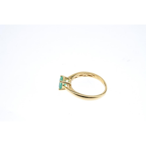 58 - An 18ct gold emerald single-stone ring. The rectangular-shape emerald, with tapered shoulders. Hallm...