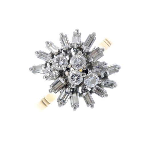 583 - An 18ct gold diamond cluster ring. The brilliant-cut diamond stepped line, with baguette-cut diamond...