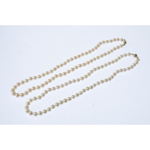 584 - Two cultured pearl single-strand necklaces. Each designed as a series of cultured pearls, with spher...