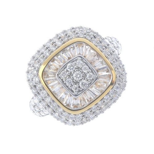 585 - An 18ct gold diamond cluster ring. The pave-set diamond square-shape panel, within a tapered baguett...