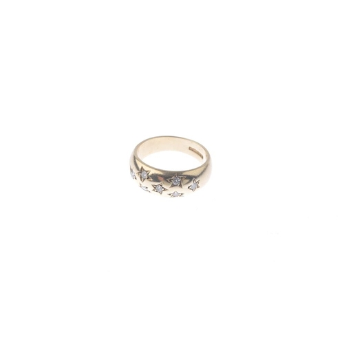 588 - A 9ct gold diamond ring. Designed as a series of scattered brilliant-cut diamond, each within a stat...