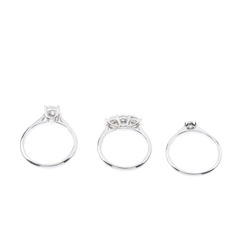 589 - Three 9ct gold diamond rings. To include a brilliant-cut diamond illusion-set three-stone ring and t...