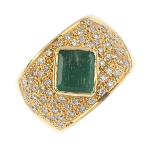 59 - An emerald and diamond dress ring. The rectangular-shape emerald collet, raised within a pave-set di...