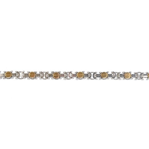 590 - Two 9ct gold bracelets. The first designed as a series of tapered bar links, the second designed as ...