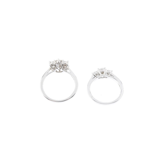 592 - Two 9ct gold diamond rings. To include a brilliant-cut diamond illusion-set cluster ring and a brill...