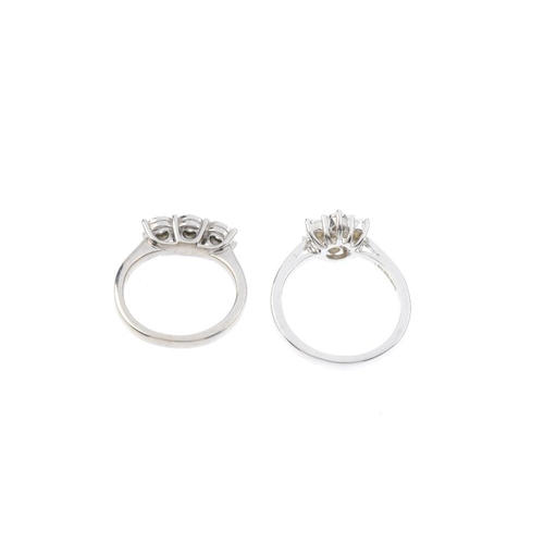 597 - Two 9ct gold diamond rings. To include a brilliant-cut diamond illusion-set cluster ring and a brill...