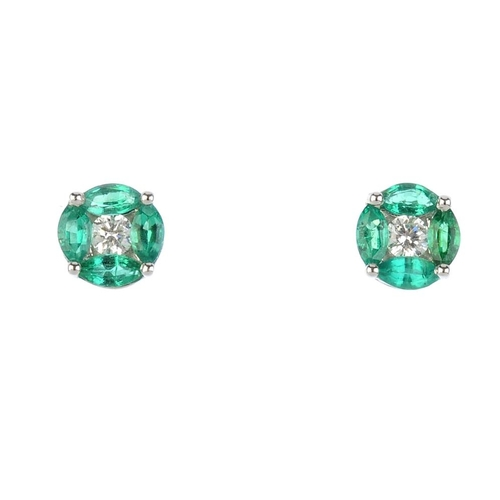 6 - A pair of emerald and diamond cluster stud earrings. Each designed as a brilliant-cut diamond, withi...