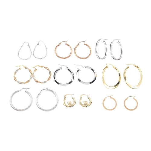 602 - Eleven pairs of hoop earrings. To include a pair of 9ct gold twist design hoop earrings, a pair of 9...