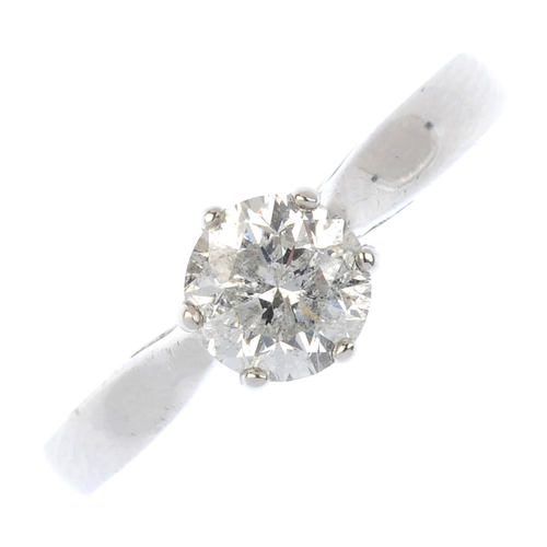 603 - An 18ct gold diamond single-stone ring. The brilliant-cut diamond, with tapered shoulders. Estimated...