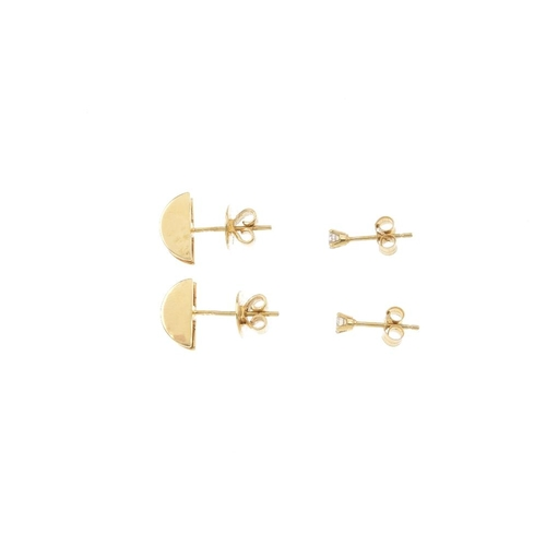 608 - Two pairs of diamond earrings. To include a pair of 18ct gold brilliant-cut diamond semi-circular de...
