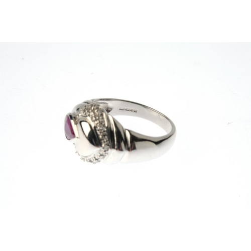609 - A 9ct gold glass-filled ruby and diamond dress ring. The pear-shape glass-filled ruby and single-cut...