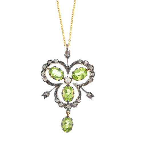 610 - A gem-set pendant. The peridot drop, suspended from a cultured pearl and peridot trefoil, within a b...