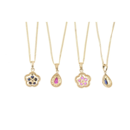 612 - Four gem-set and diamond pendants. To include a 9ct gold ruby and diamond floral pendant, a sapphire...