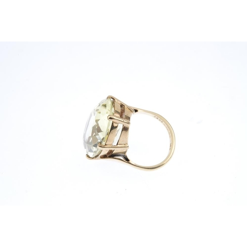 614 - A 9ct gold citrine ring. The oval-shape citrine, with openwork gallery and plain band. Hallmarks for...