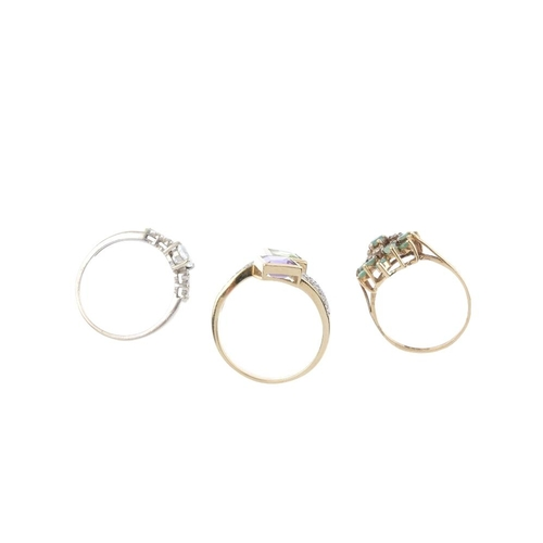 616 - Three diamond and gem-set rings. To include a 9ct gold aquamarine and diamond ring, a 9ct gold emera...