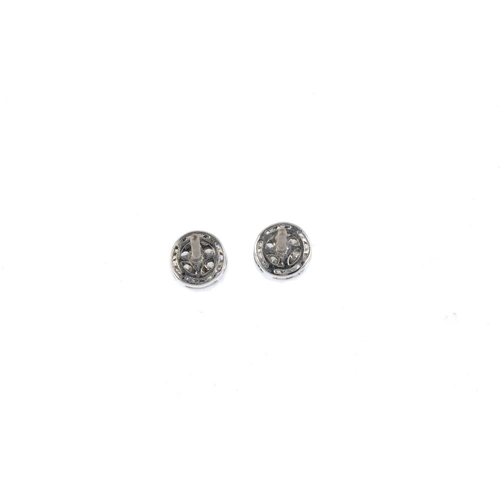 62 - A pair of diamond earrings. Each designed as a pave-set diamond disc. Estimated total diamond weight...