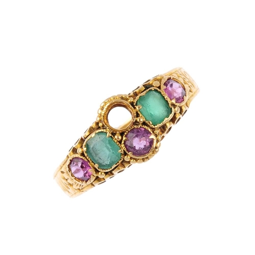 621 - A mid Victorian 15ct gold gem-set ring. The twin circular-shape garnets, with cushion-shape green pa...