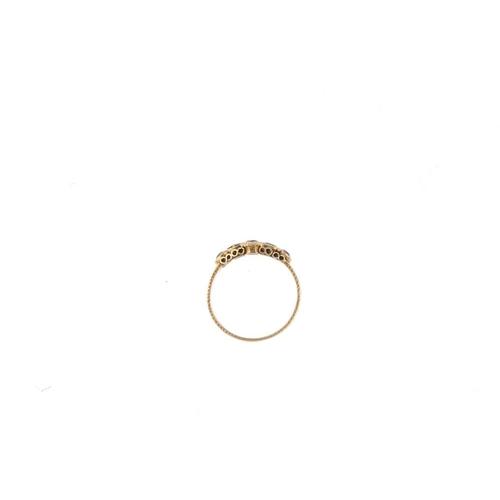 621 - A mid Victorian 15ct gold gem-set ring. The twin circular-shape garnets, with cushion-shape green pa...