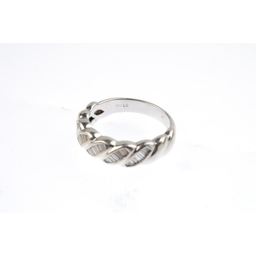 622 - A diamond dress ring. Designed as a series of baguette-cut diamond overlapping lines, with similarly...