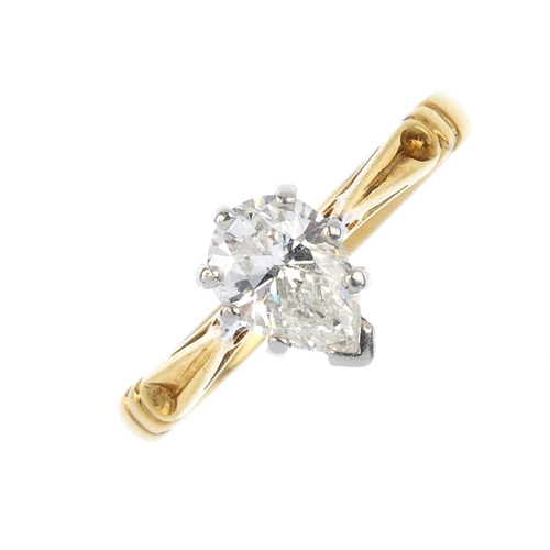 623 - An 18ct gold diamond single-stone ring. The pear-shape diamond, with tapered shoulders and plain ban...