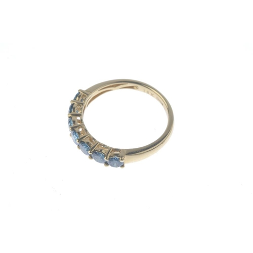 629 - An 18ct gold colour treated diamond seven-stone ring. The colour treated 'blue' brilliant-cut diamon...