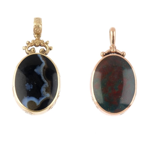 633 - Two 9ct gold gem-set pendants. Each of oval-shape outline, set to either side with an oval-shape gem...