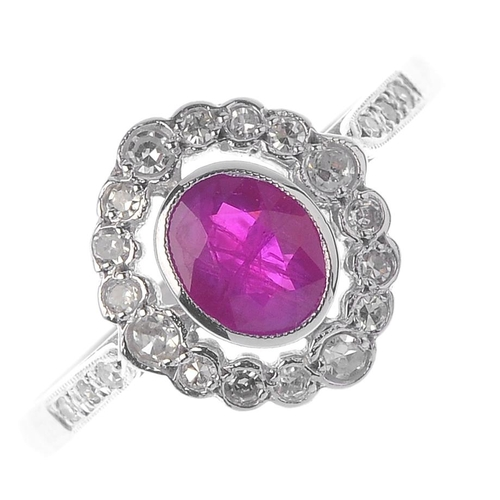 636 - A ruby and diamond cluster ring. The oval-shape ruby, with a single-cut diamond scalloped halo and s...