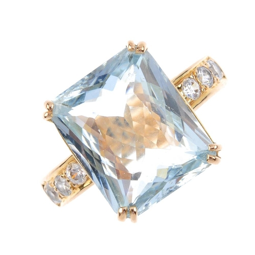 637 - An aquamarine and Swarovski crystal ring. The rectangular-shape aquamarine, with circular-shape colo...