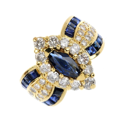 643 - An 18ct gold sapphire and diamond ring. The marquise-shape sapphire and brilliant-cut diamond cluste...