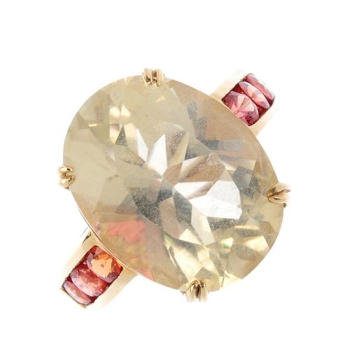 645 - A citrine and gem-set ring. The oval-shape citrine, with circular-shape orange gem line sides. Ring ...