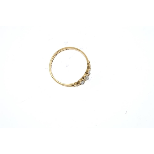 648 - A late Victorian 18ct gold split pearl and diamond dress ring. The graduated split pearl line, with ...