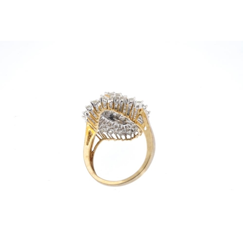 65 - A 9ct gold diamond cluster ring. The brilliant-cut diamond marquise-shape cluster, within a brillian...