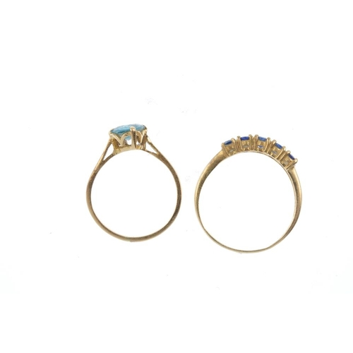 650 - Two gem-set dress rings. To include a circular-shape sapphire five-stone ring, together with a circu...