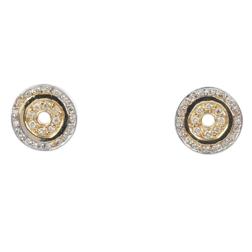 653 - A pair of diamond earrings. Each designed as a brilliant-cut diamond circle, with similarly-cut diam...