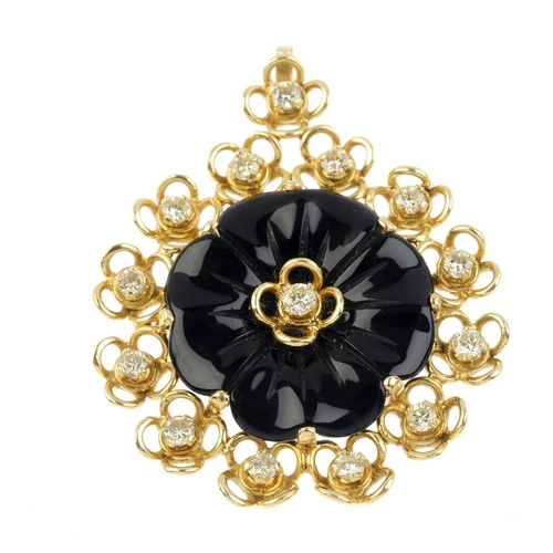 661 - A 1970s 18ct gold onyx and diamond pendant. Of foliate design, the brilliant-cut diamond and carved ...