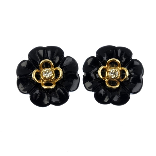 662 - A pair of 1970s 18ct gold onyx and diamond earrings. Each of floral design, the brilliant-cut diamon...
