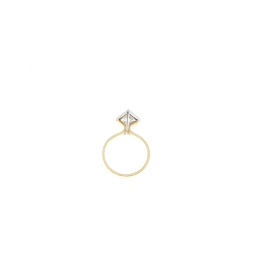 665 - An 18ct gold cubic zirconia dress ring. Of bi-colour design, the triangular-shape cubic zirconias, w...