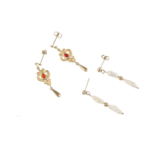 667 - Two pairs of earrings The first pair designed as a 9ct gold pear-shape garnet within a scrolling sur...