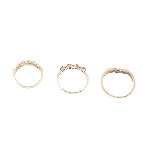 67 - Three 9ct gold ruby and diamond rings. To include a ruby and diamond line ring, a ruby and diamond c...