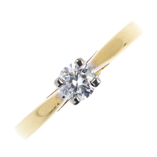 671 - An 18ct gold diamond single-stone ring. The brilliant-cut diamond, with tapered shoulders. Diamond w...