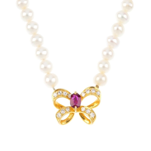 673 - A cultured pearl, ruby and diamond necklace. Comprising seventy-two cultured pearls, with a ruby and...