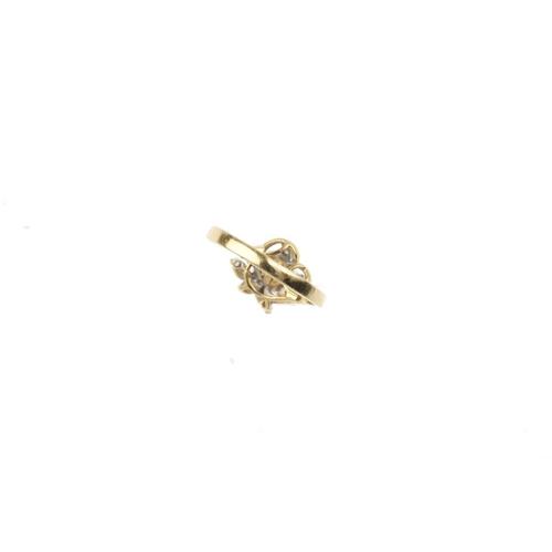679 - A cultured pearl and diamond dress ring. The cultured pearl, with brilliant-cut diamond foliate surr...