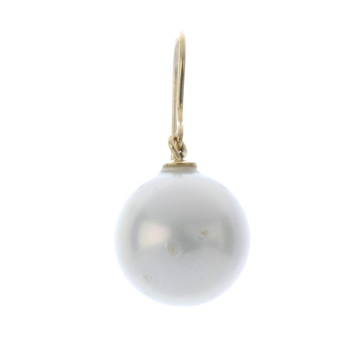 681 - An imitation pearl single earring. The imitation pearl, measuring 14mms, suspended from a hook fitti...